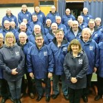 Choir members in their new waterproof jackets bought with money from the Big Lottery Fund